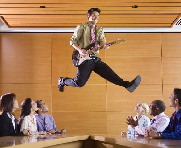 Man playing music at a meeting
