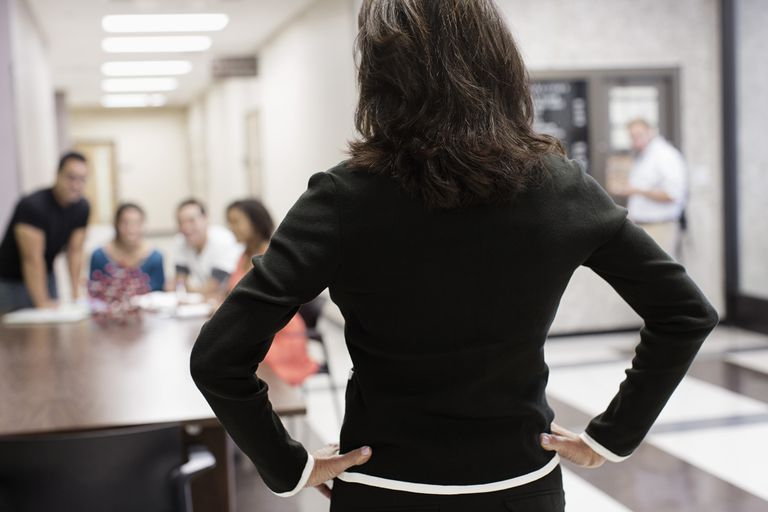 Teacher watching students in hallway
