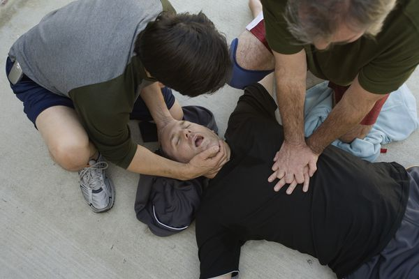 men doing cpr on another man