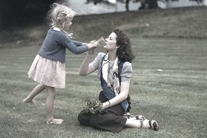actress Margaret Lockwood and her daughter playing outside