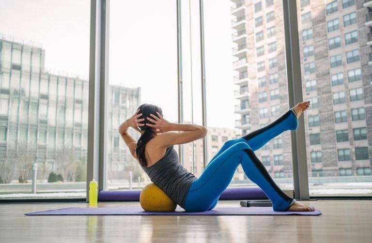 Woman strength training in studio