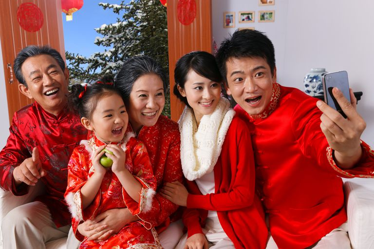 Chinese family dressed in red posing for a selfie