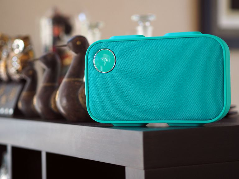 A Caribbean green Libratone ONE Click Bluetooth speaker resting on a shelf