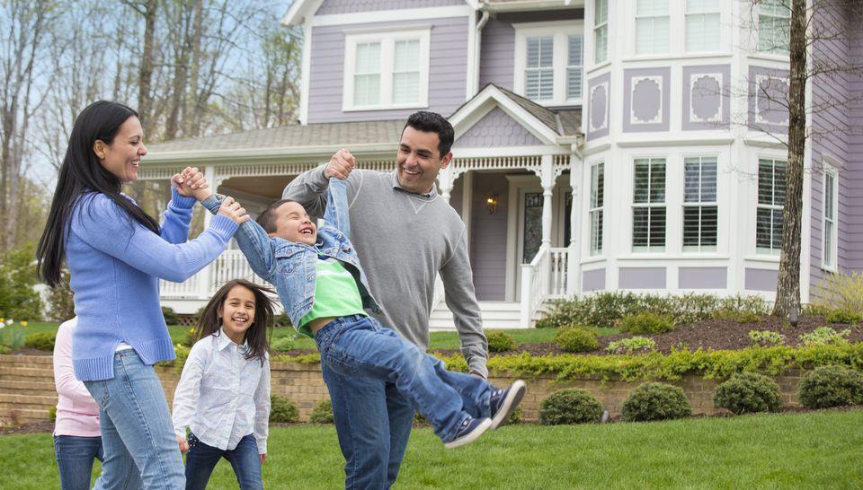 Hispanic family playing in front yard