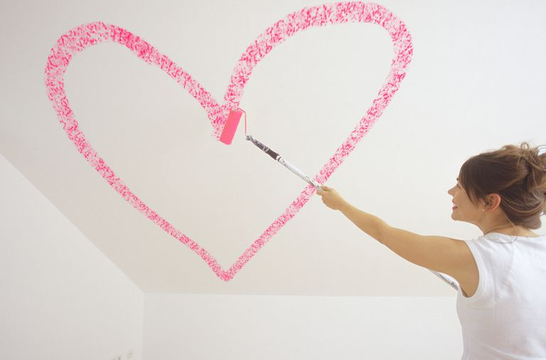 A Woman Painting a Heart