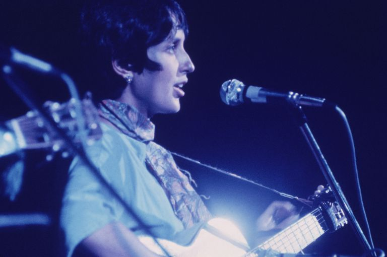 Joan Baez playing guitar and singing at Woodstock Festival, August 1969