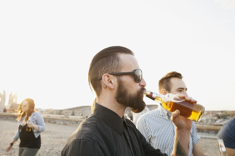 Man drinking bottle of beer