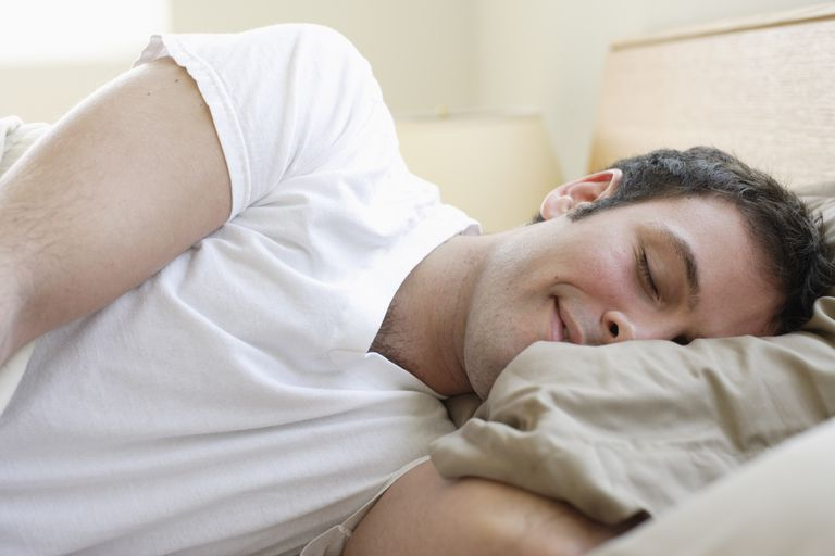 Man having a wet dream during normal sleep
