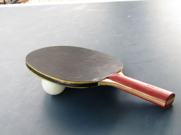 Close-Up Of Table Tennis Racket And Ball