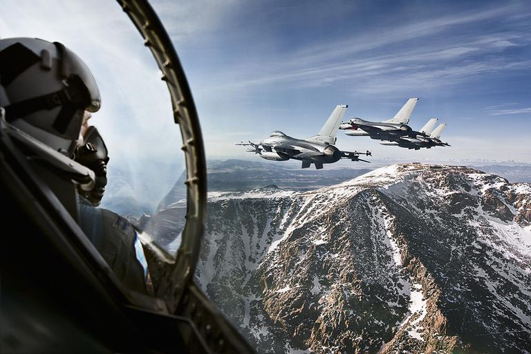 F-16 fighter pilots flying over Pikes Peak.