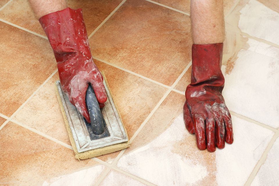 Cleaning off excess tile grout.