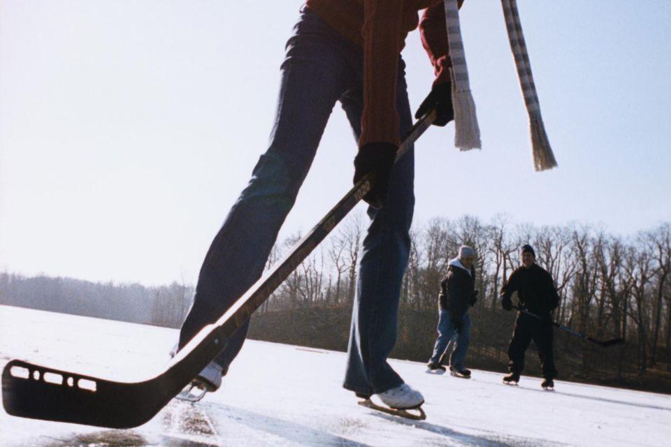 Group Play Ice Hockey on Lake