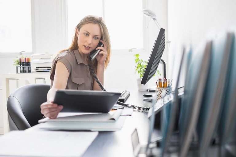 Portrait of young woman working in office, Jersey City, New Jersey, USA