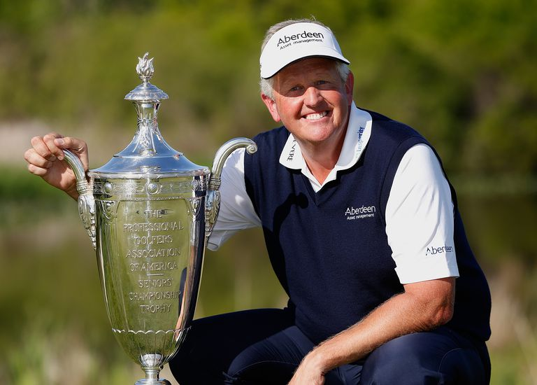Colin Montgomerie of Scotland poses with the Alfred S. Bourne Trophy after winning the 2014 Senior PGA Championship presented by KitchenAid with a winning score of -13 at the Golf Club at Harbor Shores on May 25, 2014