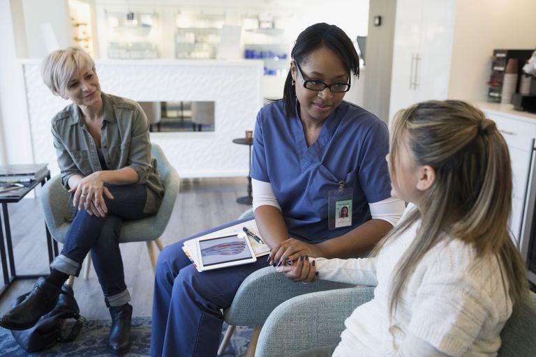 Nurse comforting patient in waiting room
