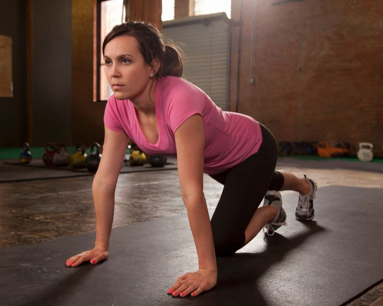 Photo of a women exercising in quadruped