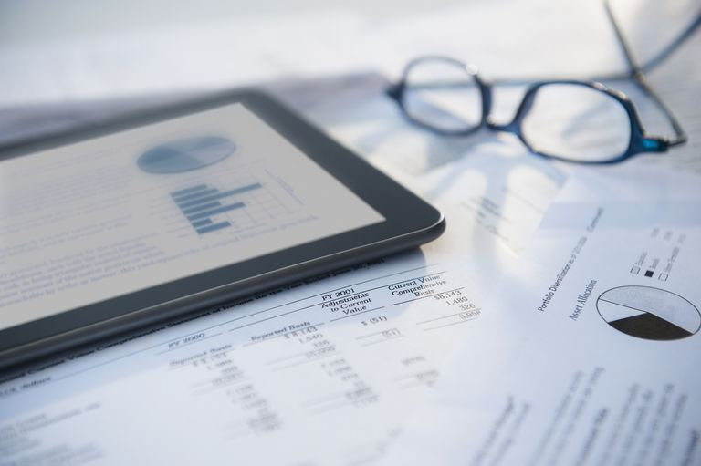 financial information on tablet and papers