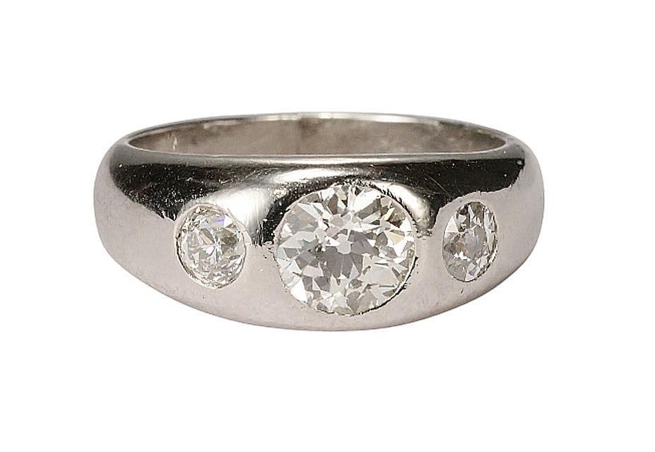 Platinum ring with gypsy set European-cut diamonds.