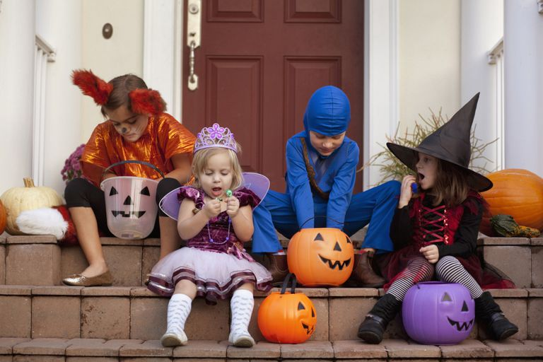 a group of children in halloween costumes sitting on a front porch - Free Halloween Costume