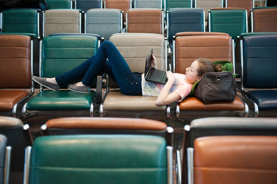 Woman lying in airport