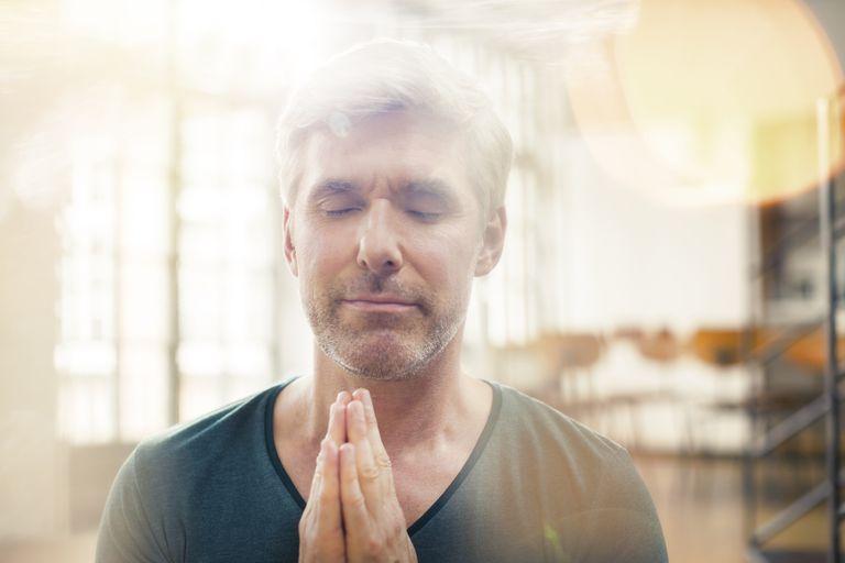 Close up of older man meditating