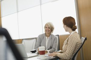 Businesswoman smiling in boardroom