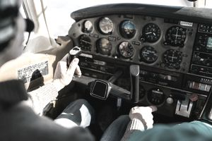 Flight instructor and student inside small Piper aircraft