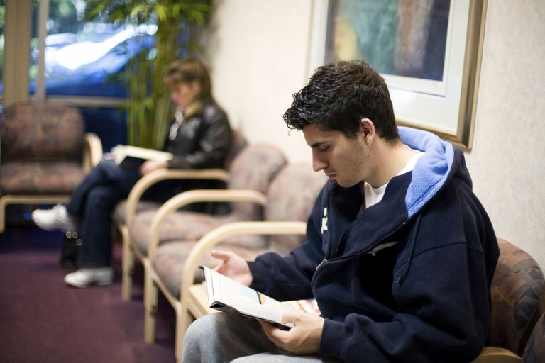 A teen waiting to see his pediatrician.