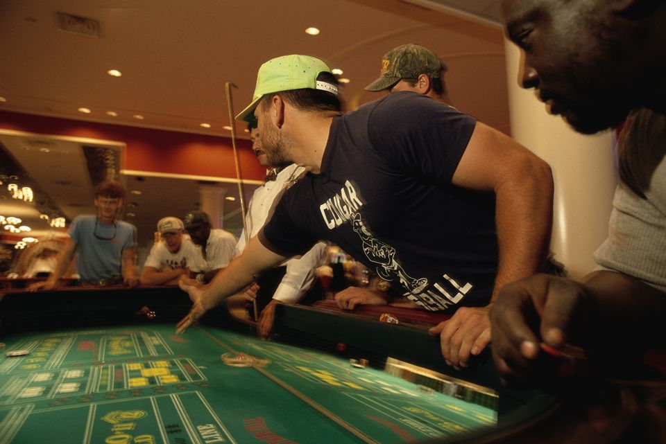 Gambler Throwing Dice on Craps Table