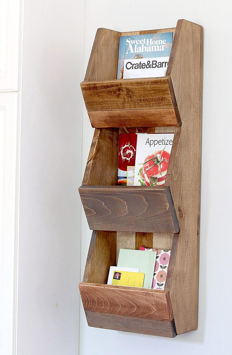 Picture of a wooden shelf with magazines and mail
