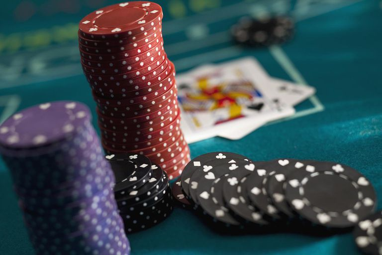 Chips at casino table with cards on table