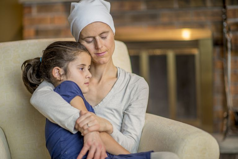 A mother with cancer holding her daughter.