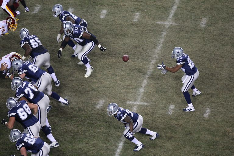 Tashard Choice #23 of the Dallas Cowboys takes the snap from the Wildcat formation during the game against the Washington Redskins