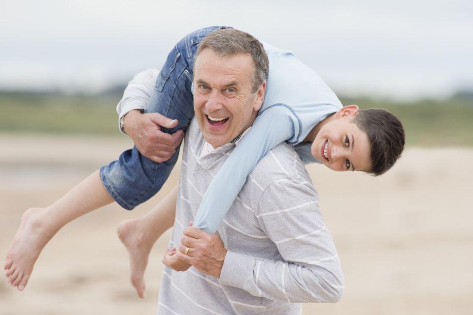 grandfather enjoying school-age grandson