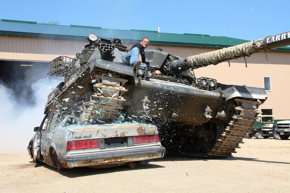 Crushing a car during a day at Drive a Tank