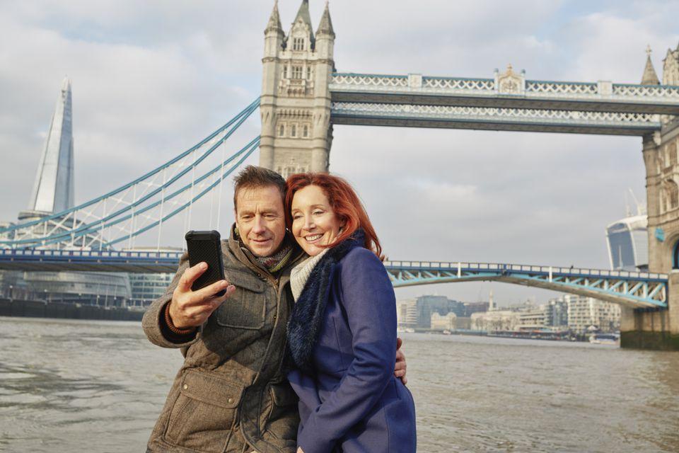 Couple taking selfie at Tower Bridge