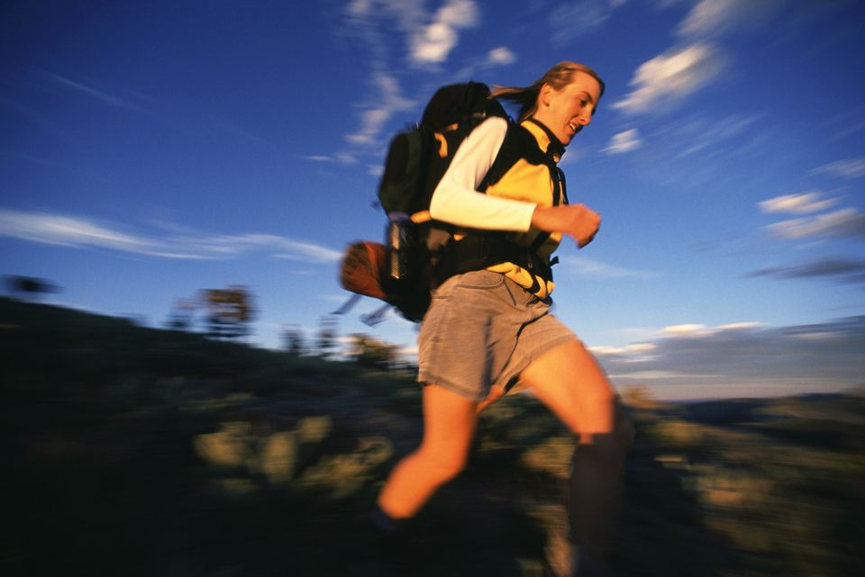 A woman hiking quickly.