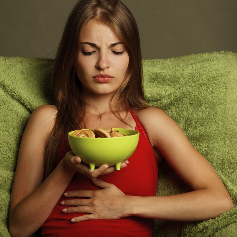 teen eating with stomach pain