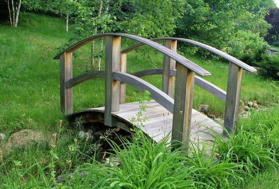 bridge crossing over grassy area