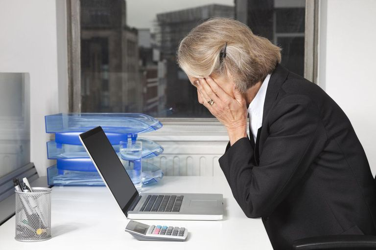 Businesswoman in front of laptop at desk in office