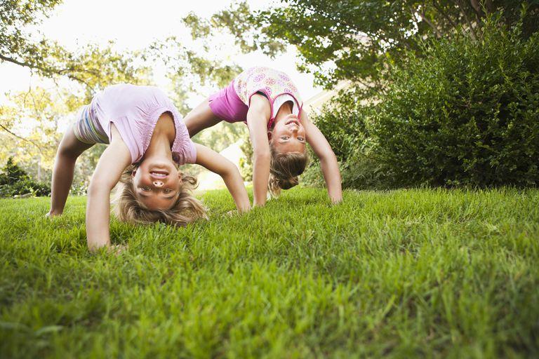Two girls playing in backyard