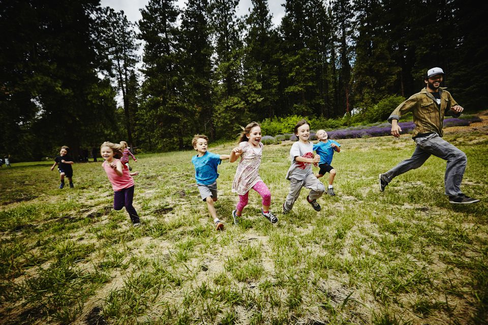 Kids and counselor play at camp