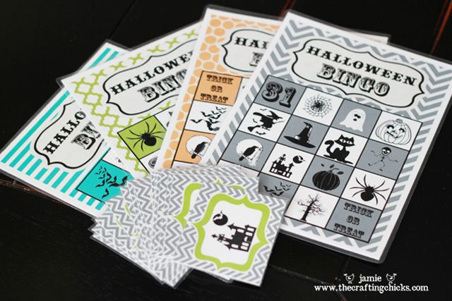 halloween bingo cards laying on a table - Free Printable Halloween Bingo Game Cards