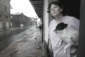 woman with dog after Hurricane Katrina