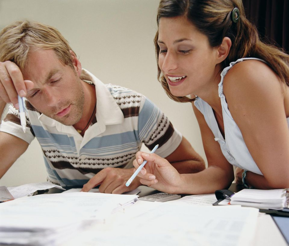 Couple doing accounts, close-up