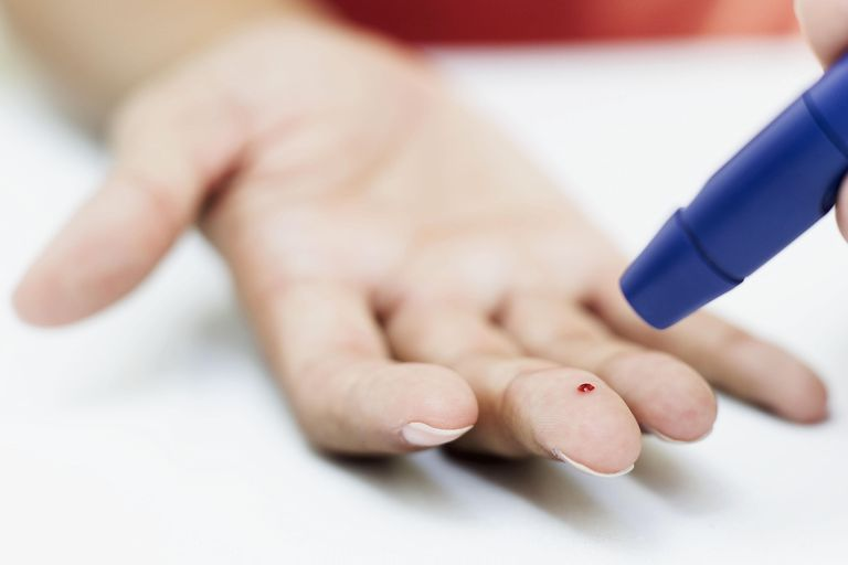 Close-up of a person's hand taking a blood test