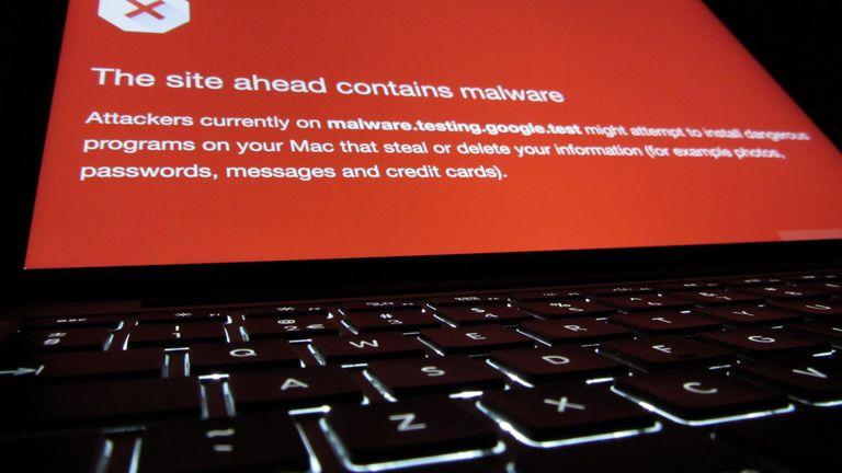 A malware alert on a laptop.