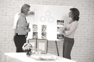 Woman looking at seating arrangements with wedding planner