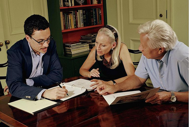 Senior couple looking over documents with financial advisor