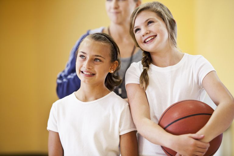 Close up of two girls with basketball